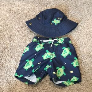 Turtle swim trunks and matching bucket hat